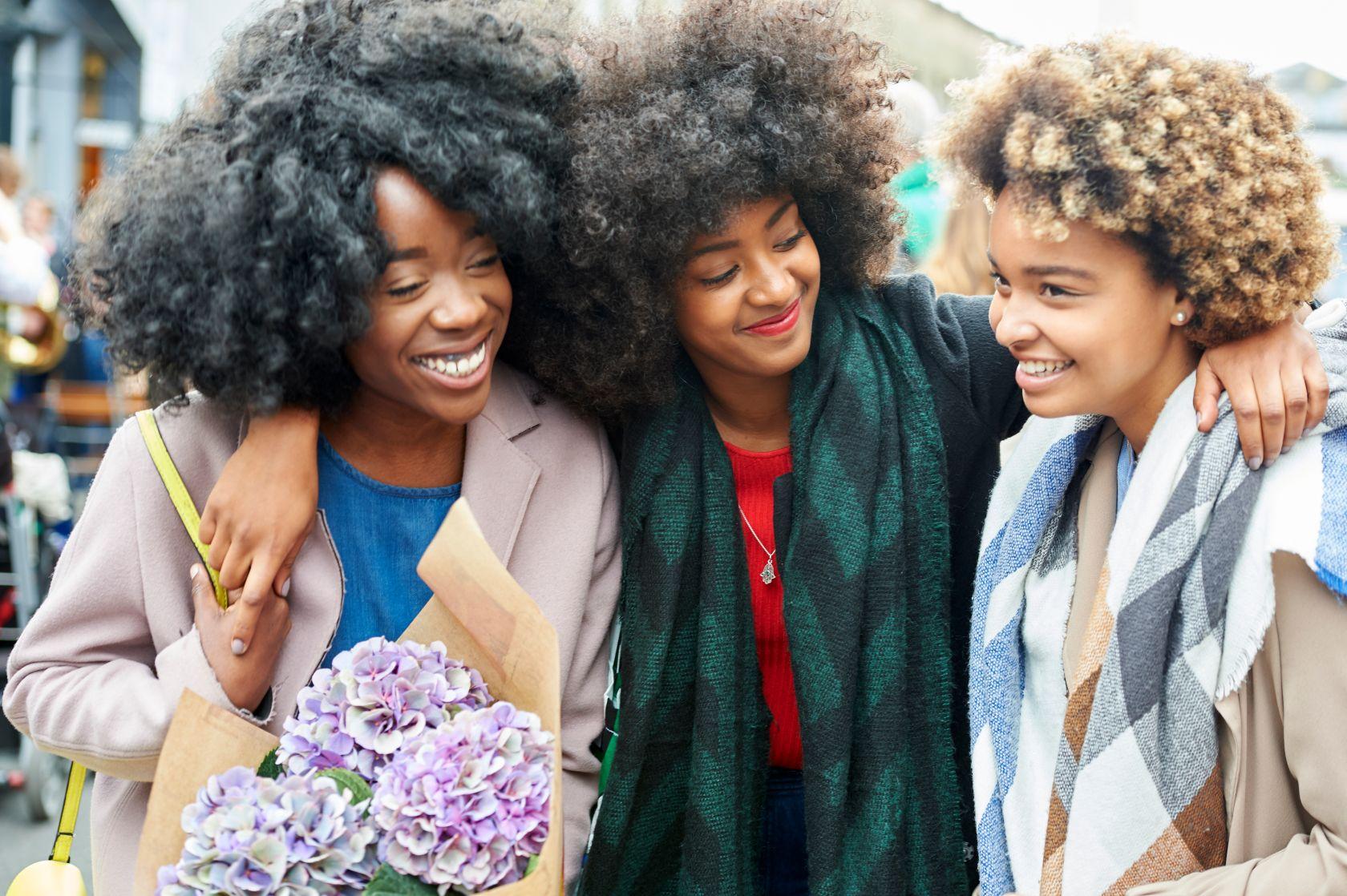 Friends shopping at a flower market.