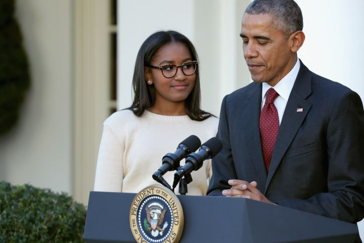 SASHA OBAMA AND HER FATHER AT THE TURKEY PARDON CEREMONY, 2015