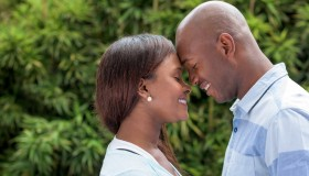 Loving black couple with heads together