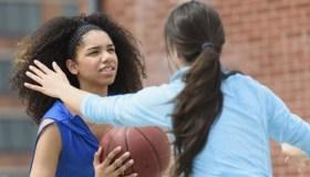USA, New Jersey, Teenage girls (14-15, 16-17) playing basketball