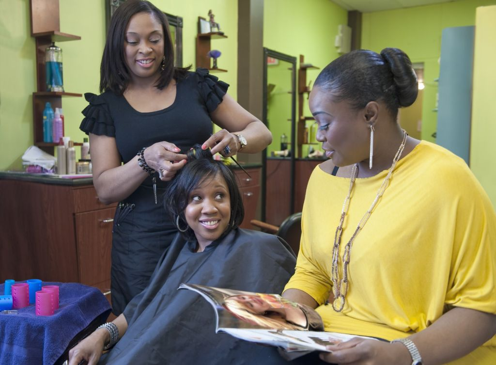 Woman with friend getting hair done at salon