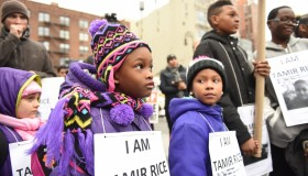 Kids with Tamir Rice signs. Stop Mass Incarcerations Network...