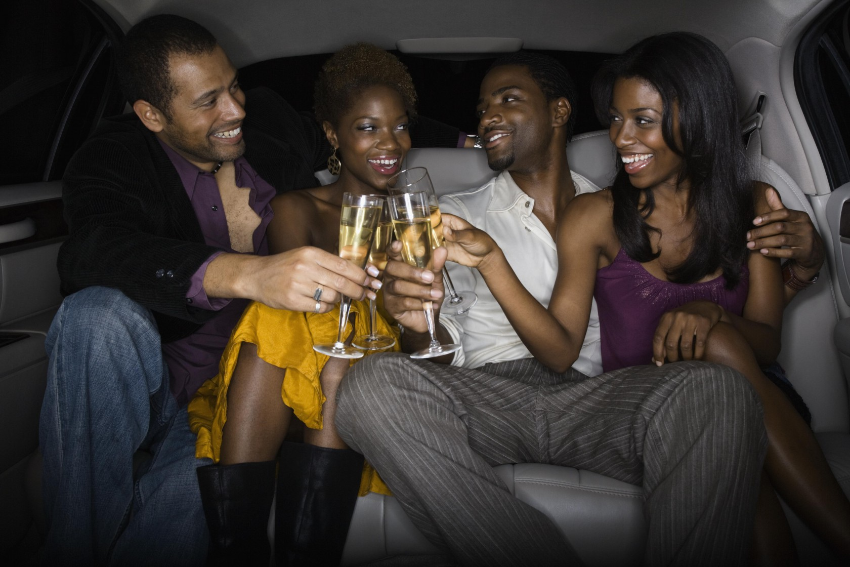 Multi-ethnic friends toasting with champagne