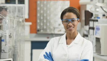 Black scientist smiling in laboratory