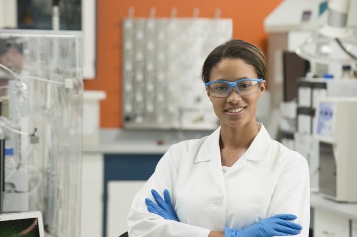 Black scientist smiling in laboratory