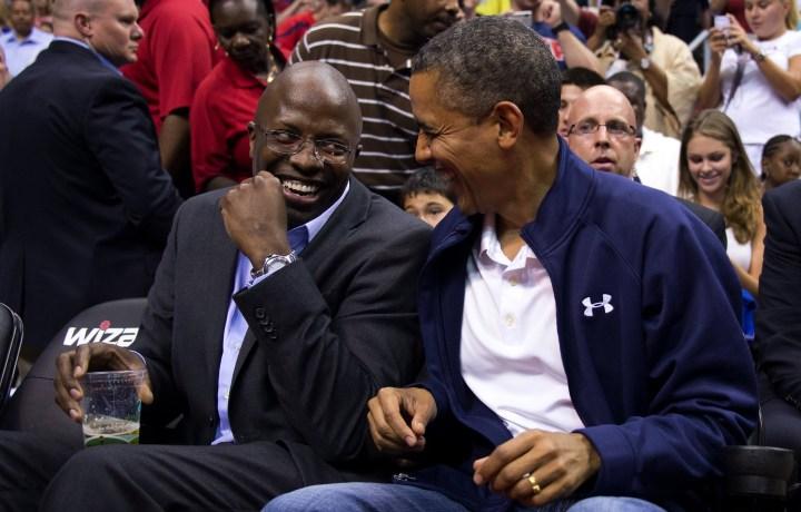 US President Barack Obama (R) shares a l