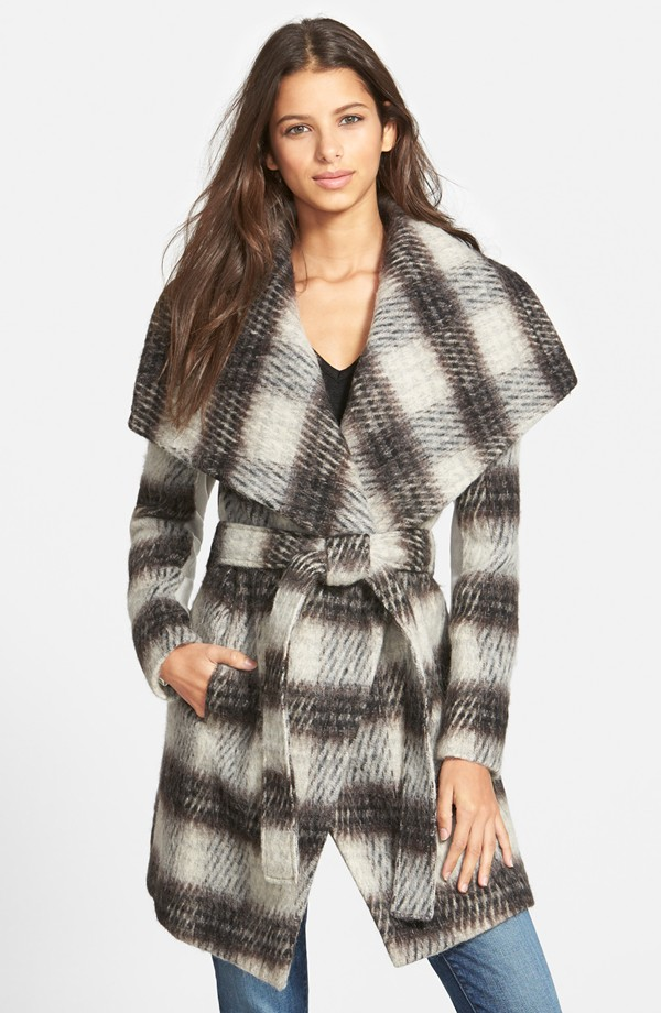 Channel Olivia Pope in a plaid wrap coat.