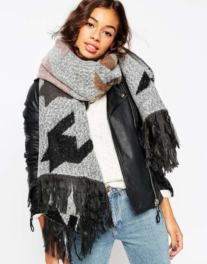 Throw on an oversized, printed scarf.