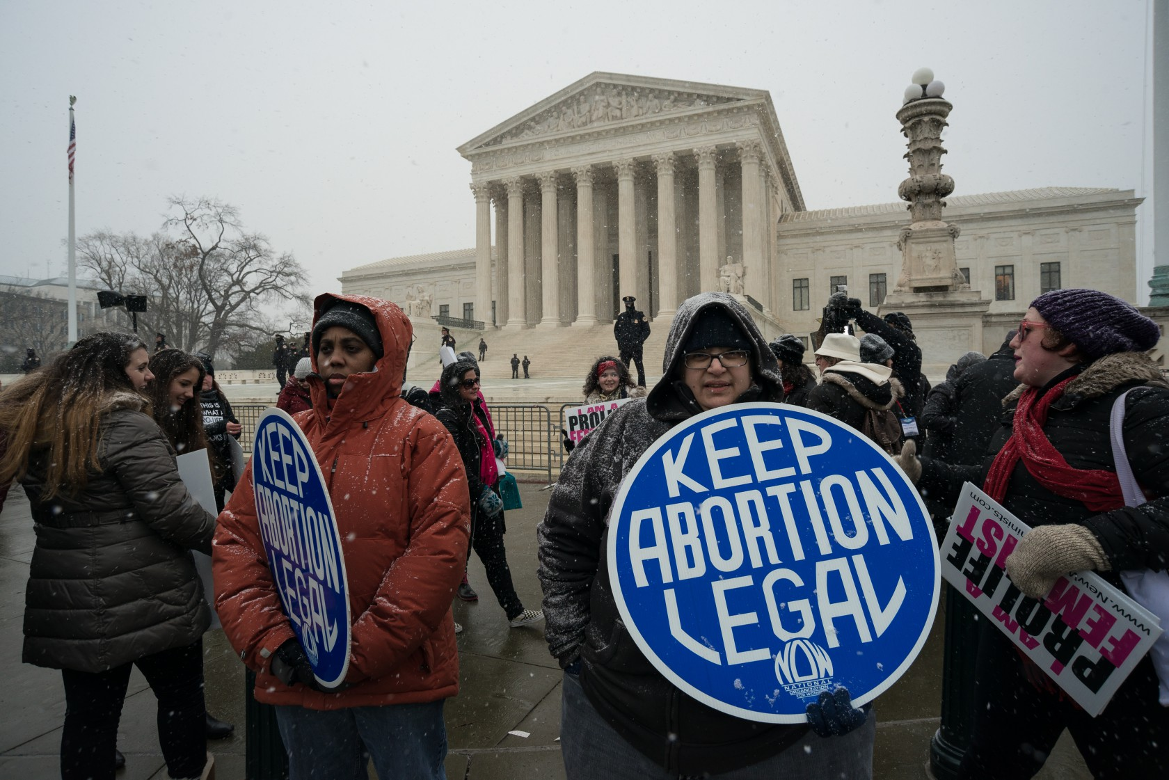 Pro-choice demonstrators stage a counter protest near the...