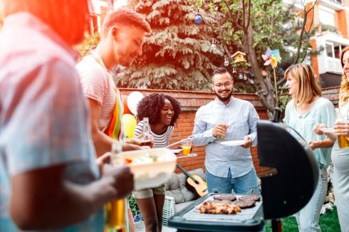 Young People Having Fun At Barbecue Party.