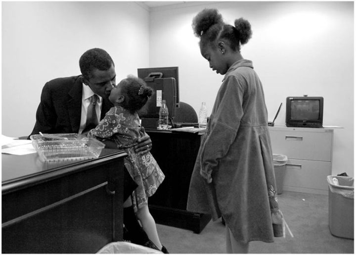 THE OBAMA GIRLS SHARE A WARM EMBRACE WITH THEIR DAD