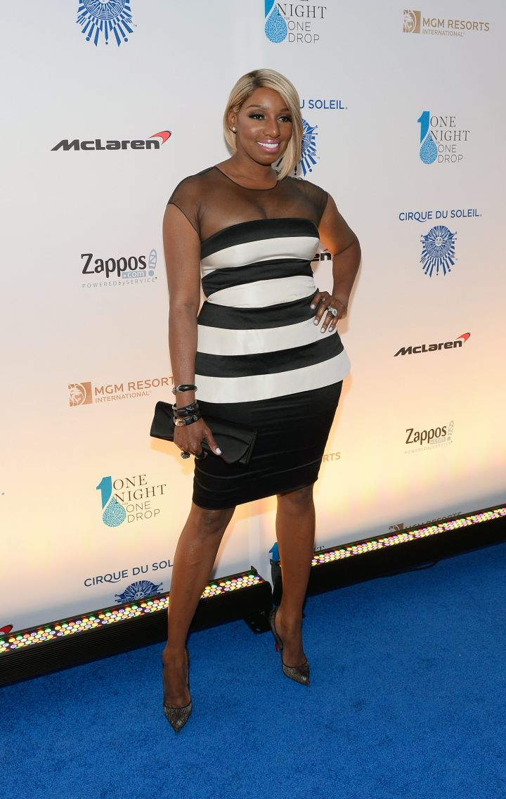 NeNe breaks fashion rules in horizontal stripes.