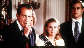 9th AUGUST 1974 Washington D. C. USA. President Richard Nixon of the United States holds back a tear as he makes his resignation speech alongside his family at the White House following the Watergate Scandal.
