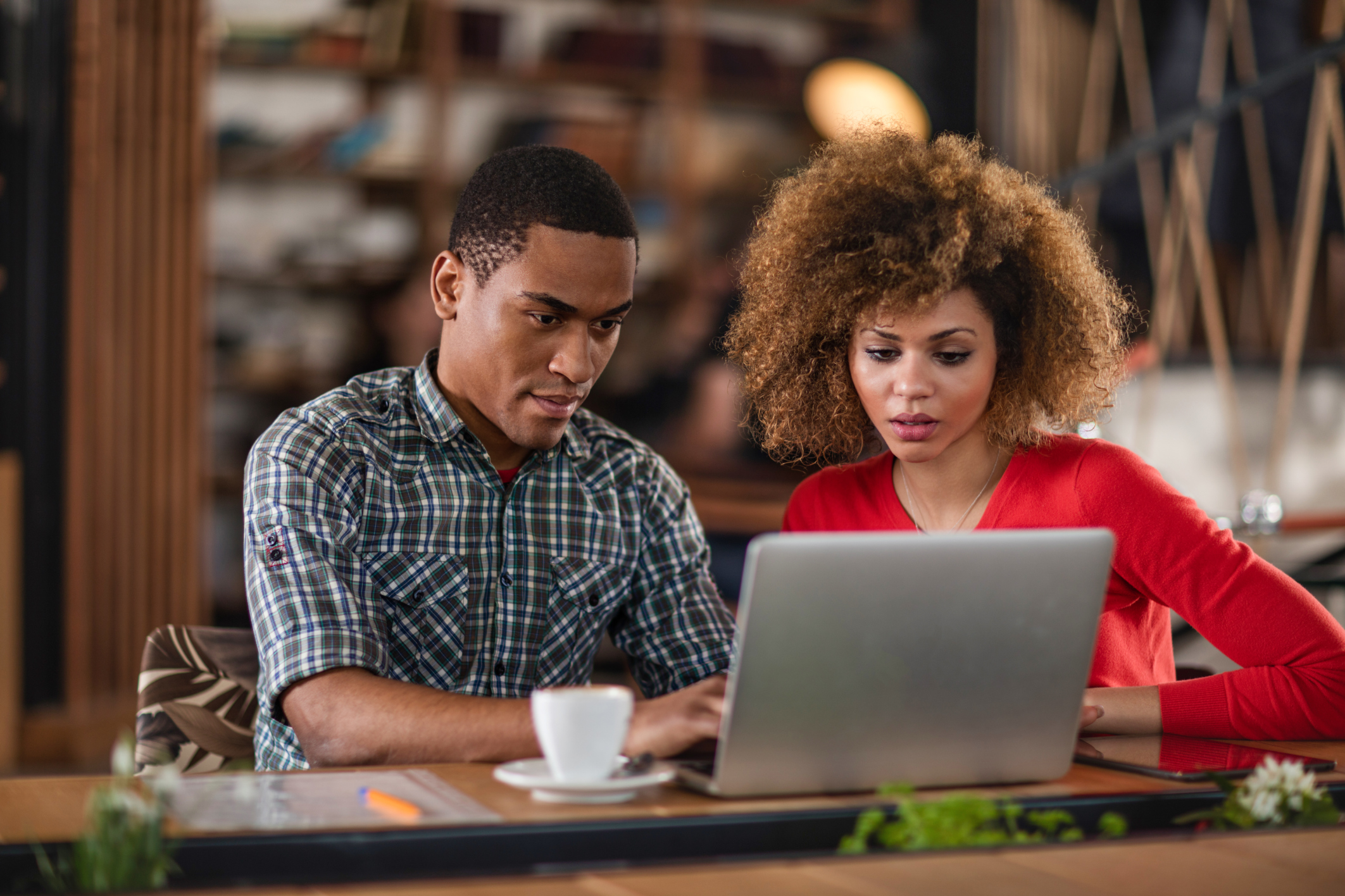 African American business colleagues working together on a laptop.