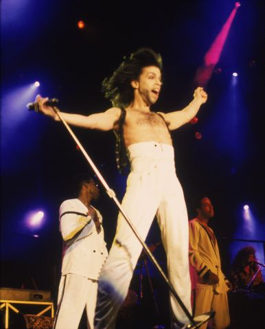Prince In Concert With Arms Outstretched