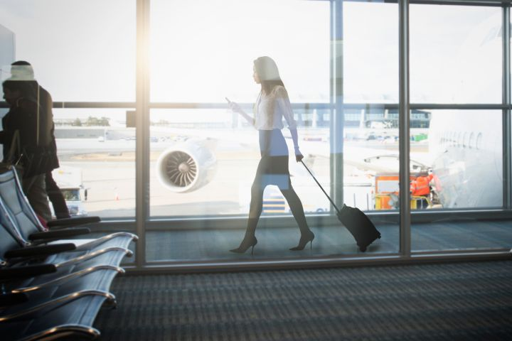 Mixed race businesswoman walking in airport