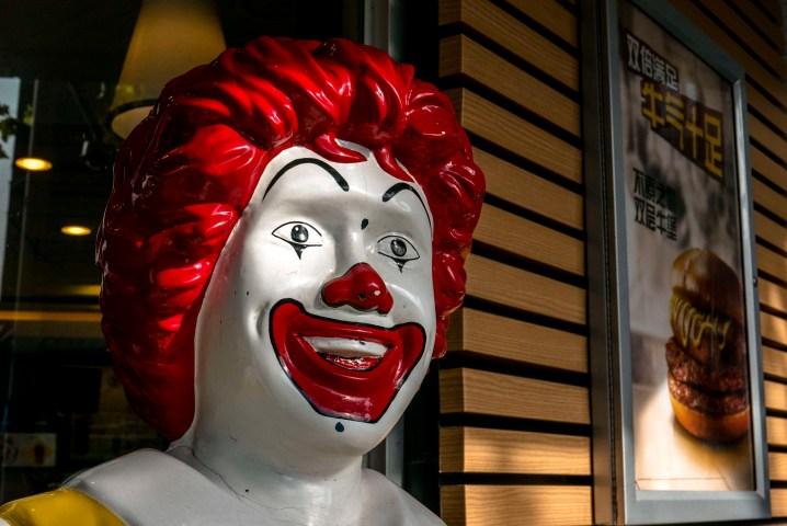 Smile face of a Ronald McDonald statue outside an McDonald's...