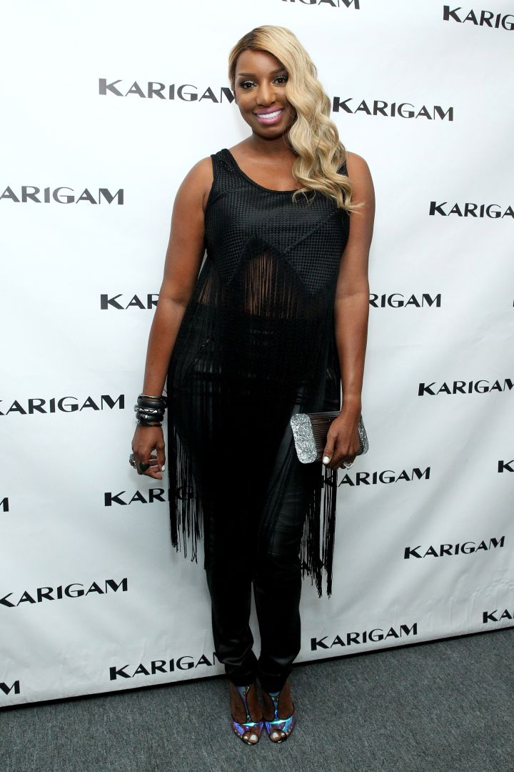 NeNe shows just a hint of skin in sexy black in 2016.