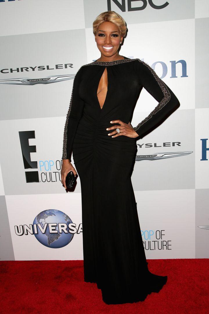 NeNe always serves in a good black gown.