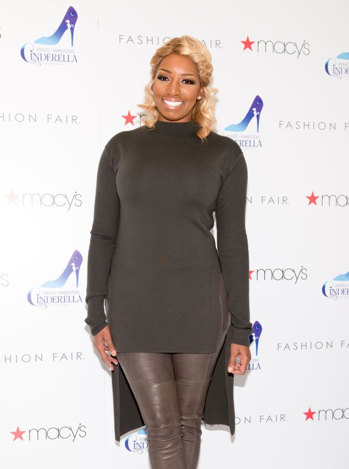 NeNe looking fabulous in olive tones.