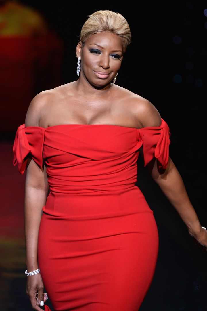 NeNe shows off her curves in red on the runway in 2014