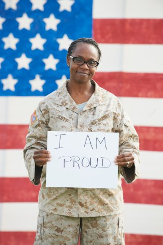 Black soldier holding empowering sign