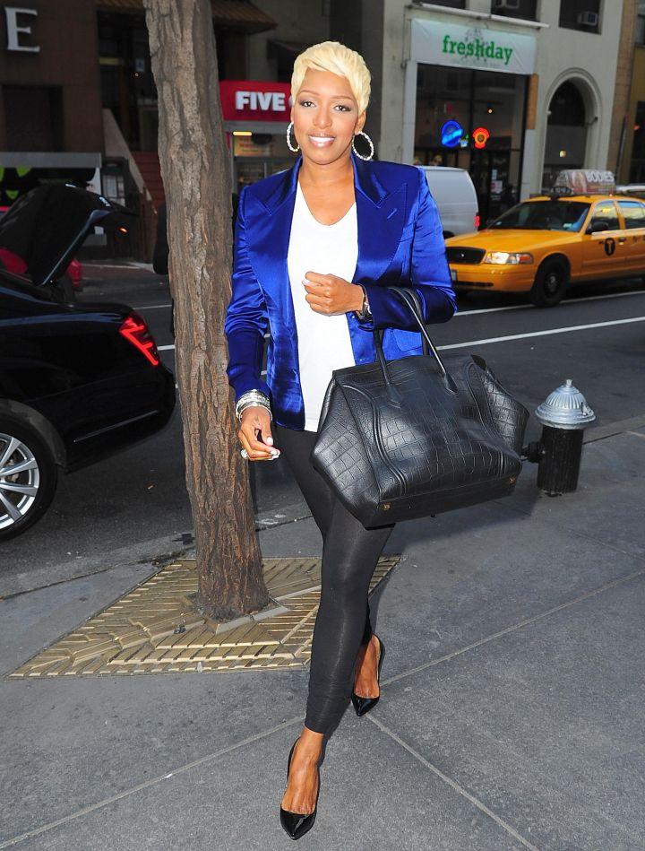NeNe rocks a fab blue blazer and heels.