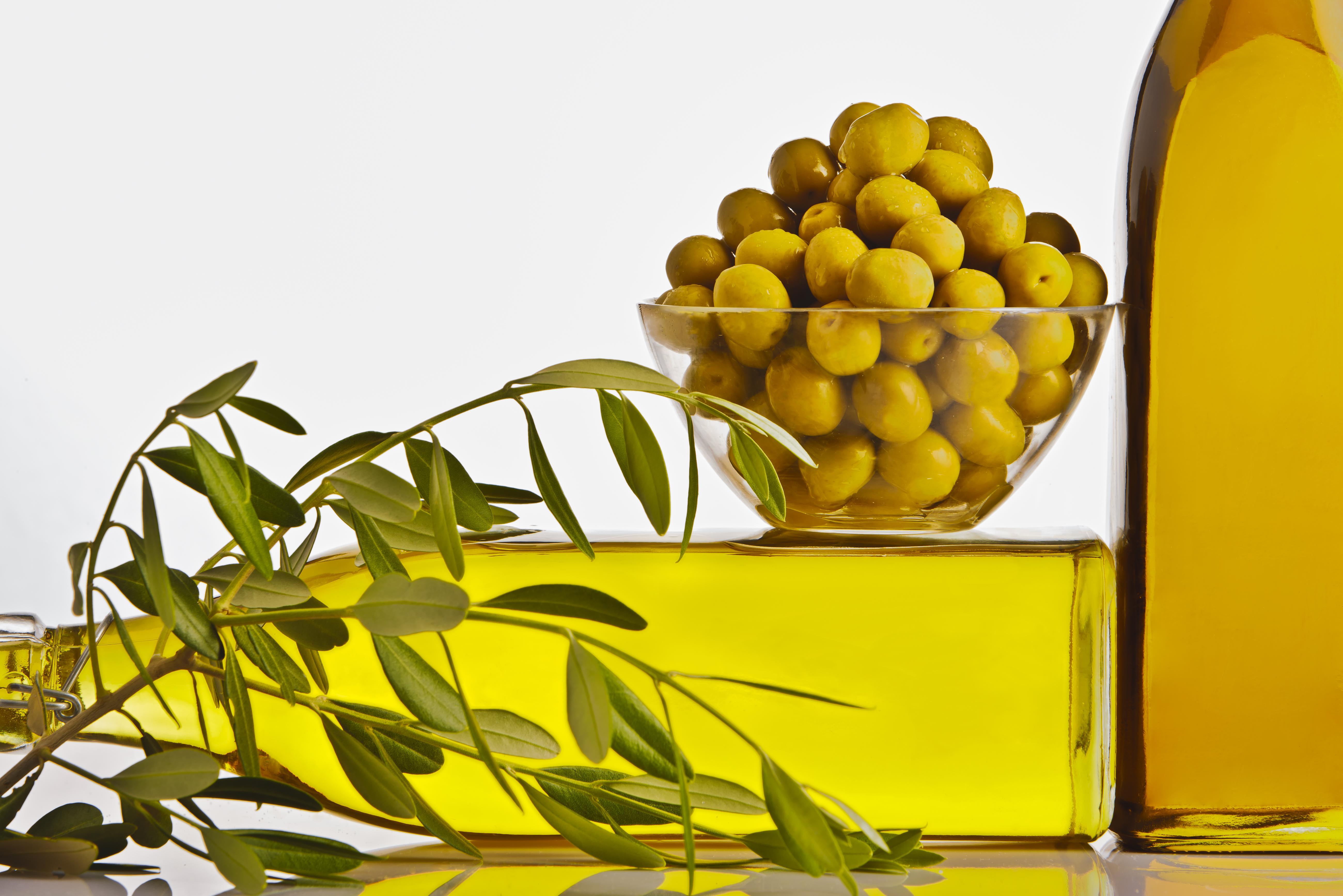 Olive oil bottles with olives
