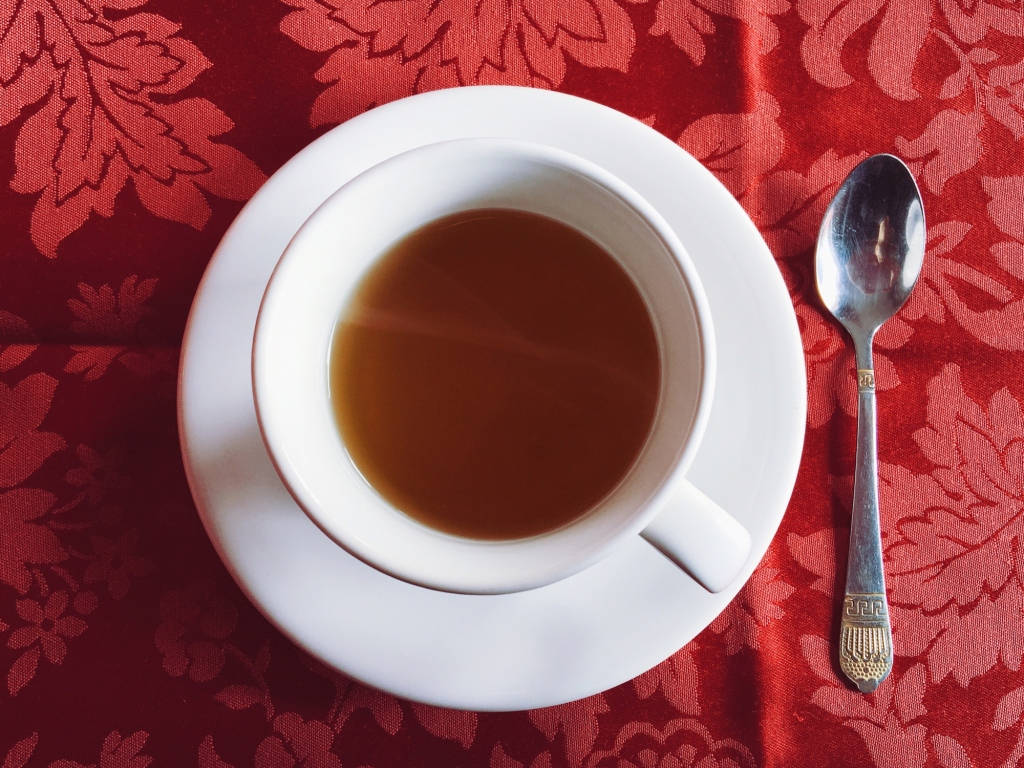 Directly Above Shot Of Tea Cup On Tablecloth