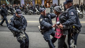 Policemen arrest a protester at the Anti-Trump rally.