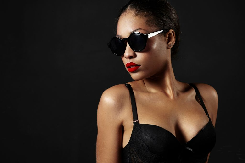Young woman with red lipstick and sunglasses