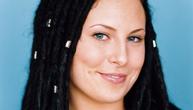 A portrait of a young lady with dreds