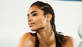 Mixed race woman with braided hair and eyes closed
