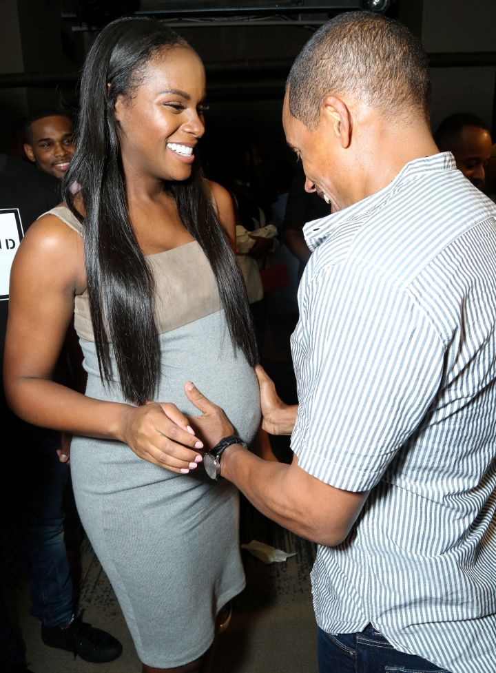 Hill Harper holds Tika Sumpter's baby bump during HelloBeautiful's screening of 'Southside with You'