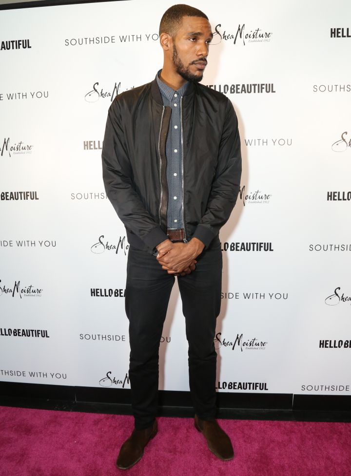 Parker Sawyers poses on the pink carpet at HelloBeautiful's screening