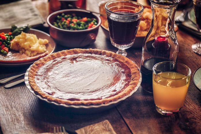 Traditional Stuffed Turkey Holiday Dinner with Vegetables and Pumpkin Pie