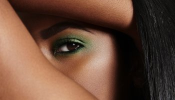 Close-up of woman's eye with green make up