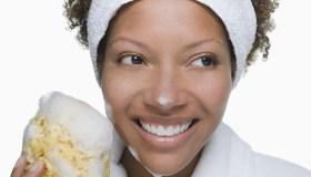 Portrait of attractive woman holding bath sponge