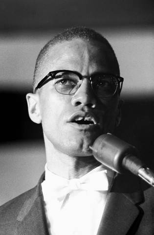 Malcolm X at Microphone