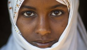 Portrait of an Afar tribe girl with a white veil, Afar region, Afambo, Ethiopia