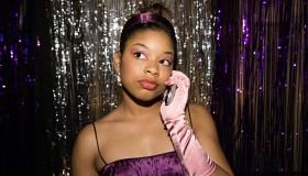 Teenage girl talking on cell phone at prom