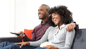 Young couple watching television.