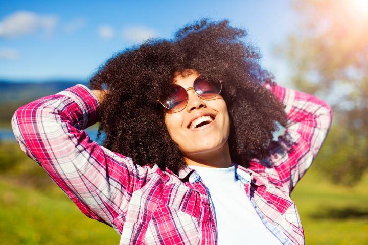 Woman relaxing in nature and feeling the joy.