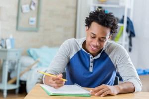 African American student works on homework