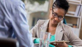 Business woman interviews prospective employee