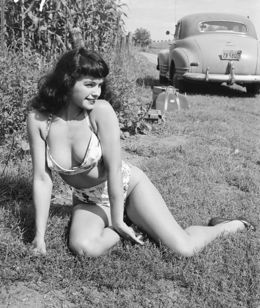 Pin-Up Page Posing Near Car