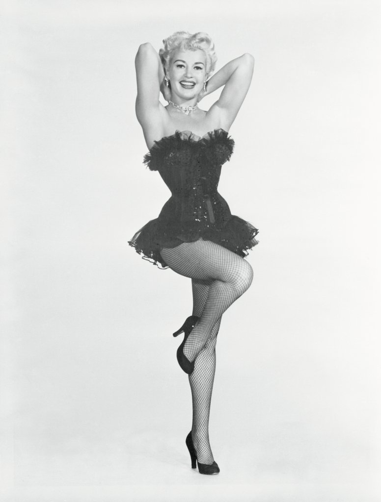 Betty Grable Posing with One Leg up and Arms Behind Her Head