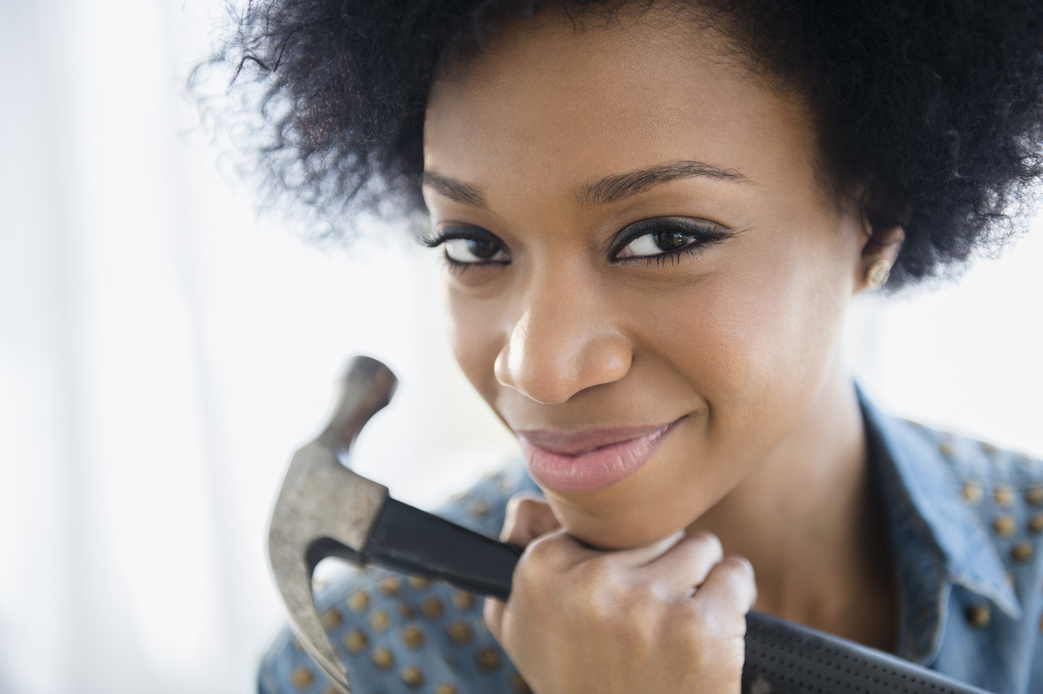 African American woman holding hammer