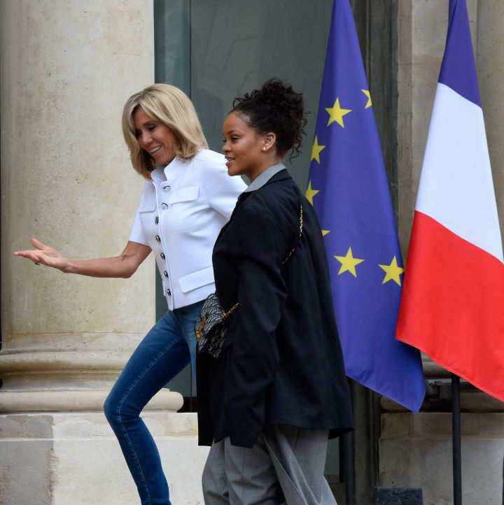 France's First Lady Brigitte Macron escorts Rihanna inside Elysee Palace