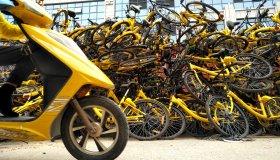 Shared Bikes Piled Up Along Street In Beijing